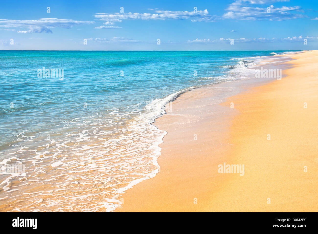 Sand beach with surf water background - Stock Image