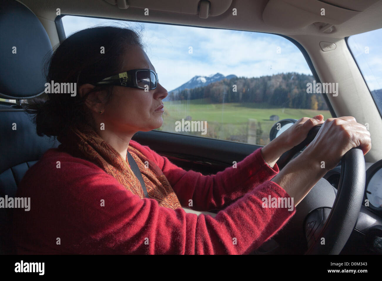 Woman drives in the Italian countryside - Stock Image