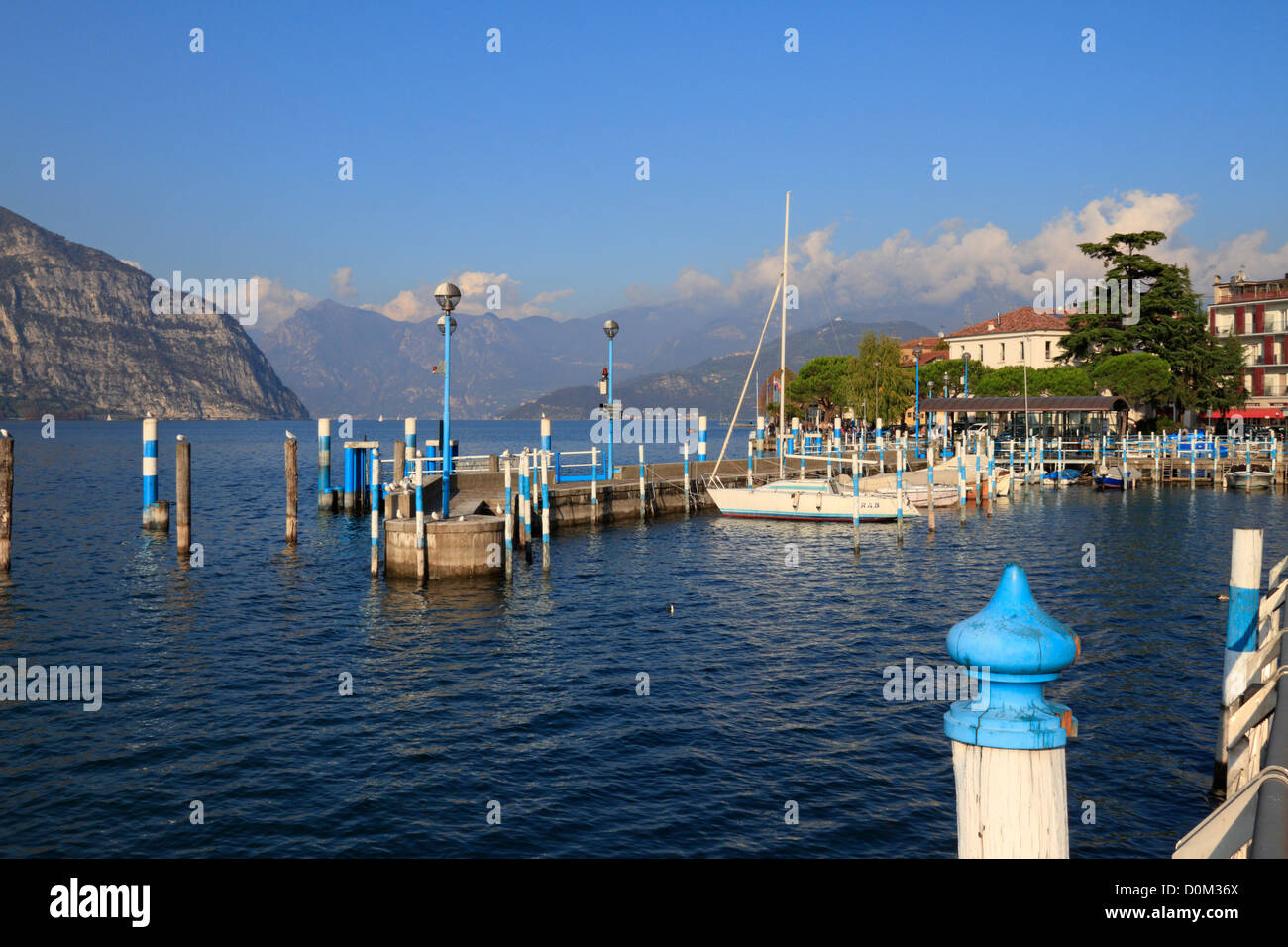 Boats in the harbour on Lake Iseo near Bergamo, Lombardy, Italy, Europe. - Stock Image