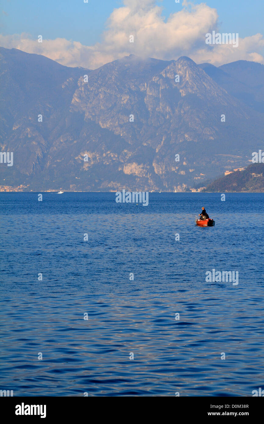 Two men fishing from a boat on Lake Iseo near Bergamo, Lombardy, Italy, Europe. - Stock Image