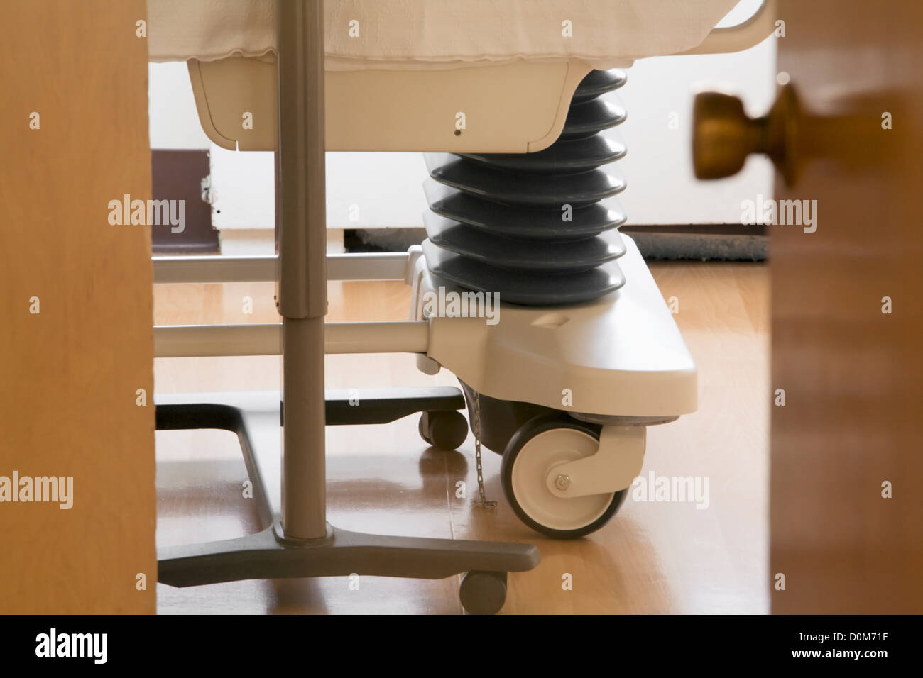 Detail of Wheels and Undercarriage of Hospital Bed - Stock Image
