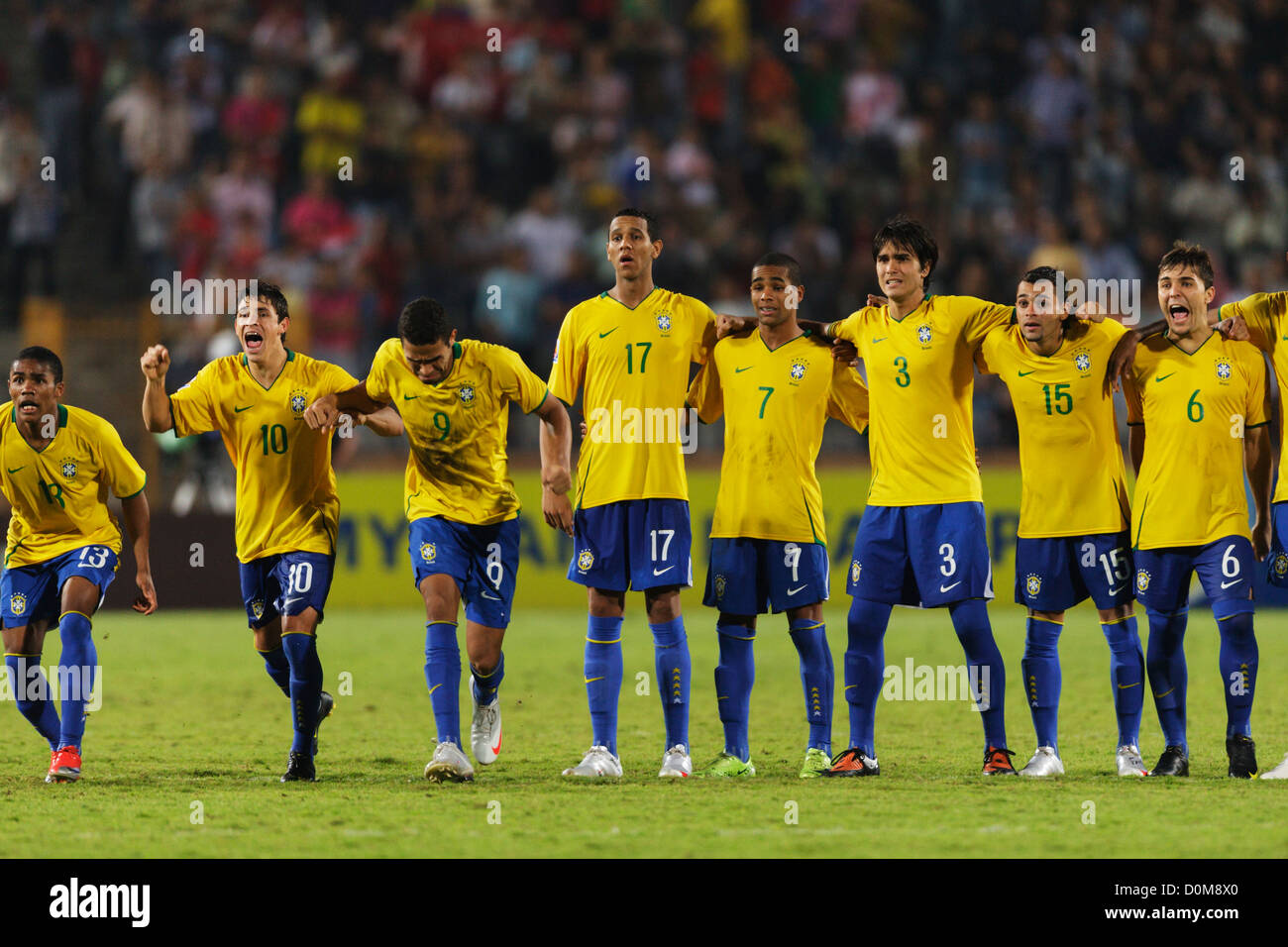 Brazil players react to a teammate's penalty kick during the shootout against Ghana to determine the 2009 FIFA - Stock Image