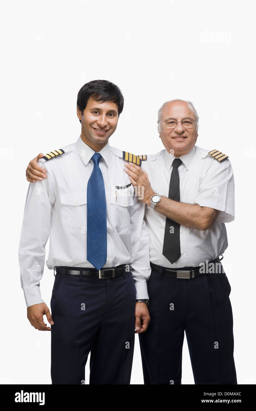 Portrait of two pilots standing together and smiling - Stock Image