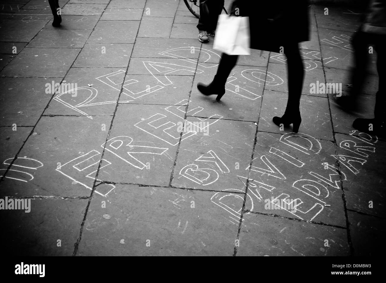 st pauls protest against capitalism in londond england pavement writing - Stock Image