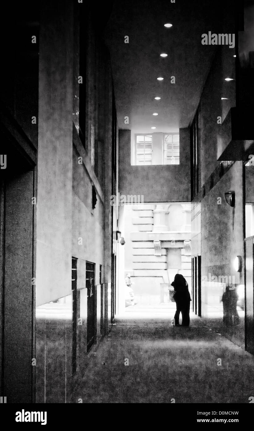 lovers, saying goodbye, city setting - Stock Image