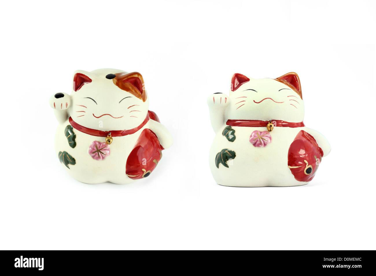 Maneki neko ( japanese fortune cat ) isolated on white - Stock Image