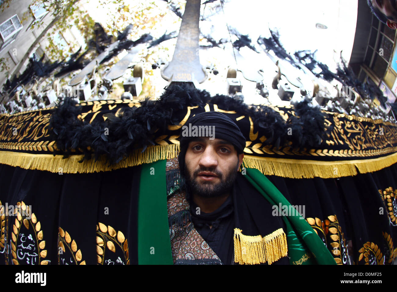TEHRAN, IRAN - NOVEMBER 26: An Iranian man carries an Alam while celebrating the day of Ashura on November 26, 2012 - Stock Image
