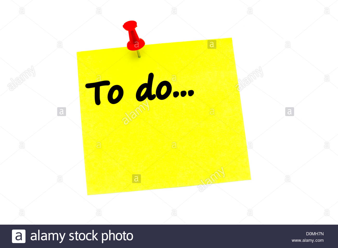 To do list on a yellow post it note held in place with a red push pin. - Stock Image