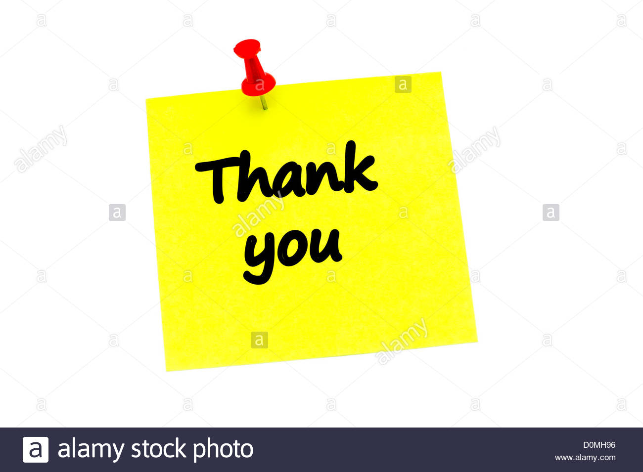 Thank you on a yellow post it note held in place with a red push pin. - Stock Image