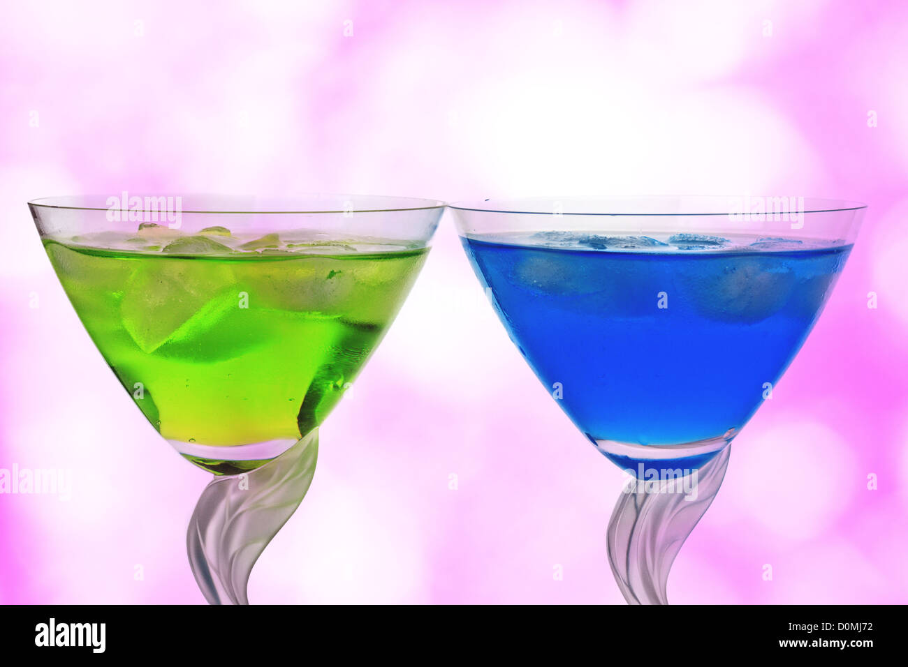 Cocktails against pink - Stock Image