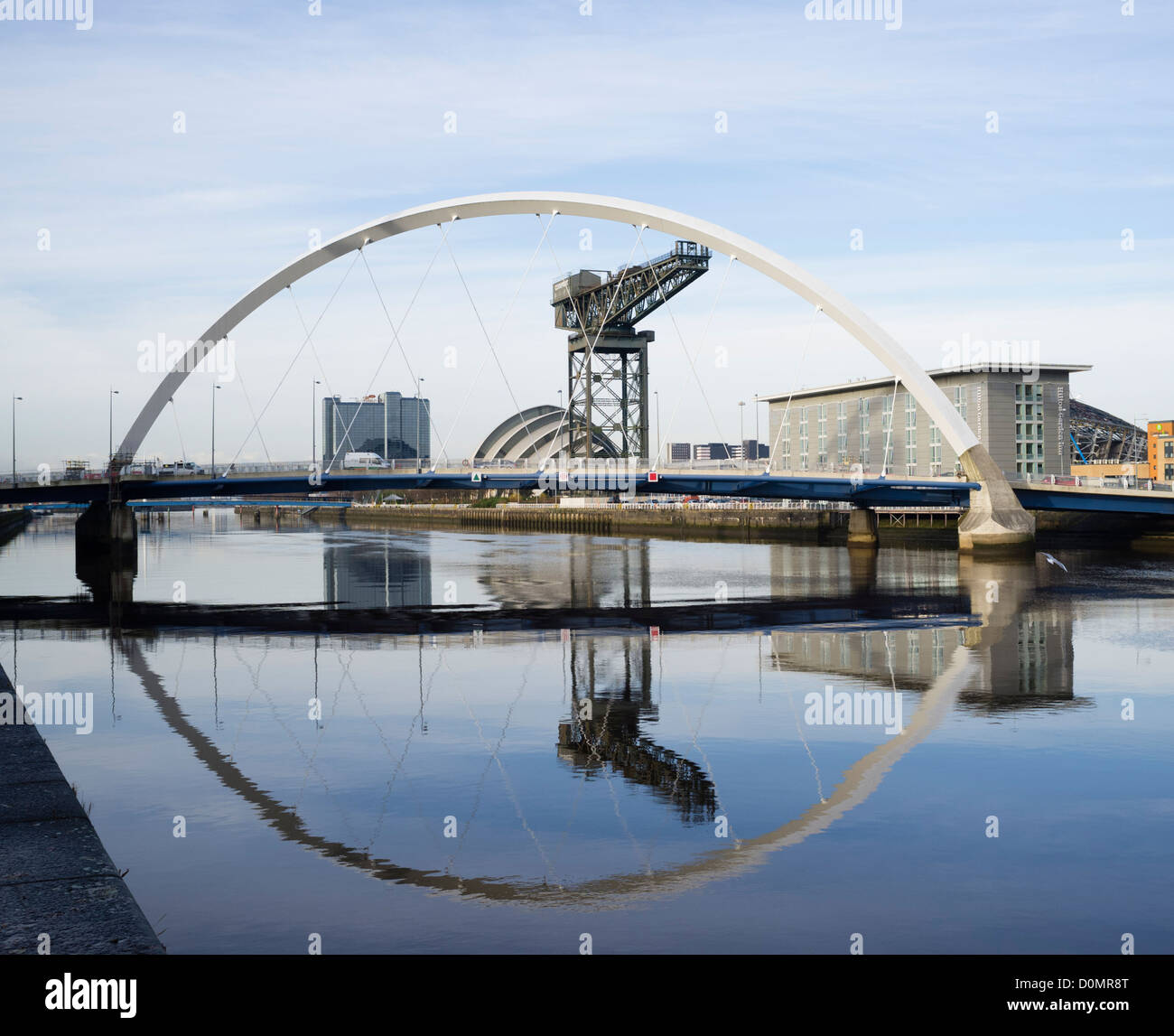 View along river Clyde towards the Arc Bridge or Squinty Bridge as it is known locally towards the  SECC in Glasgow - Stock Image