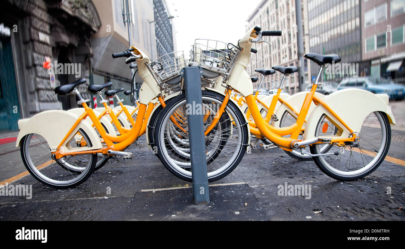 Row of bicycles for rent in Milano, Italy - Stock Image