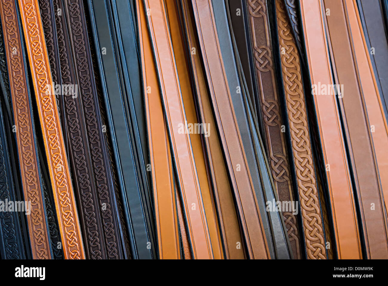 Leather belts on display and sale in outdoor market, UK - Stock Image