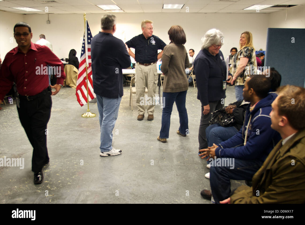 Federal Coordinating Officer Michael Byrnes receives FEMA local hires. FEMA is working with many partners including - Stock Image