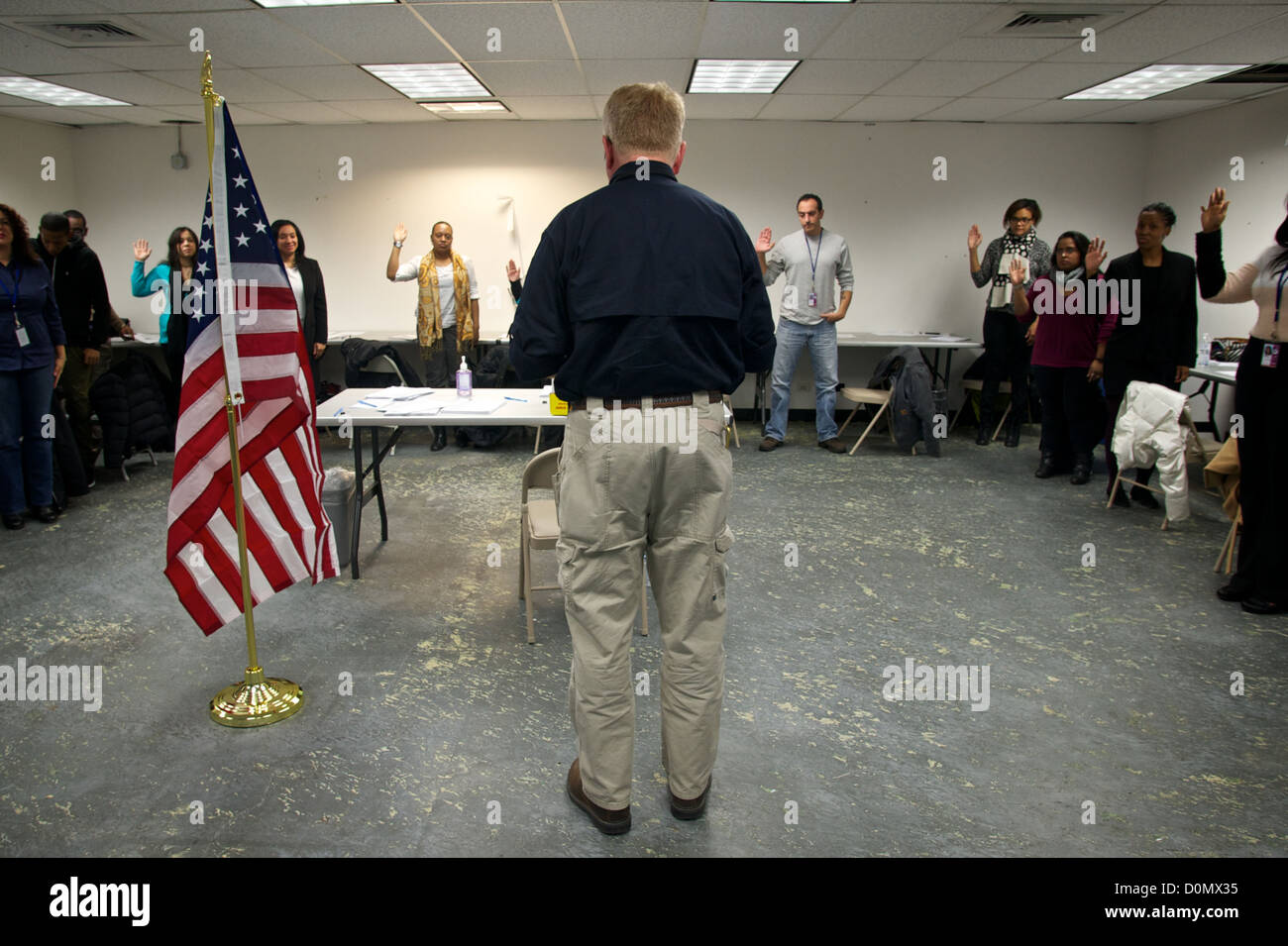 FEMA Federal Coordinating Officer Michael Byrnes swearing in New York residents as local hires to assist residents - Stock Image