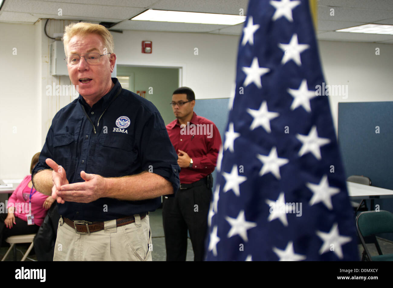 Federal Coordinating Officer Michael Byrnes talks to FEMA local hires about their job assisting residents in Hurricane - Stock Image