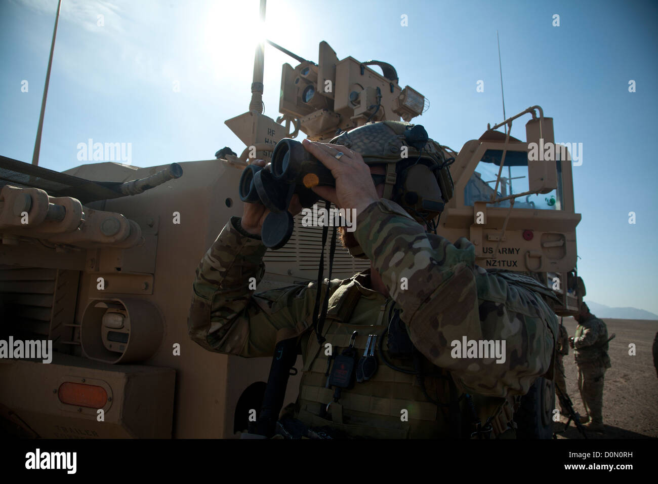A coalition force member maintains security during village stability operations in Farah province, Afghanistan, Stock Photo