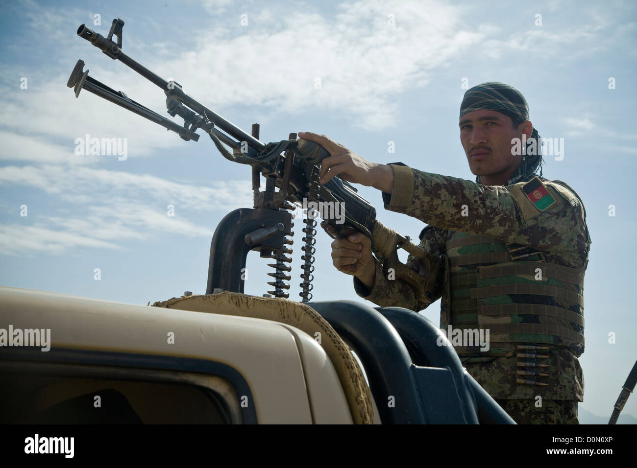 An Afghan National Army Soldier maintains security during village stability operations with coalition forces in Stock Photo