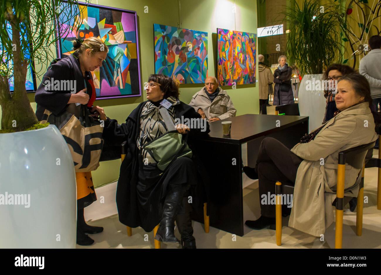 Paris, France, Group Seniors sitting at table inside Amateur Art Show, 'Art en Capital', Salon des Artistes - Stock Image
