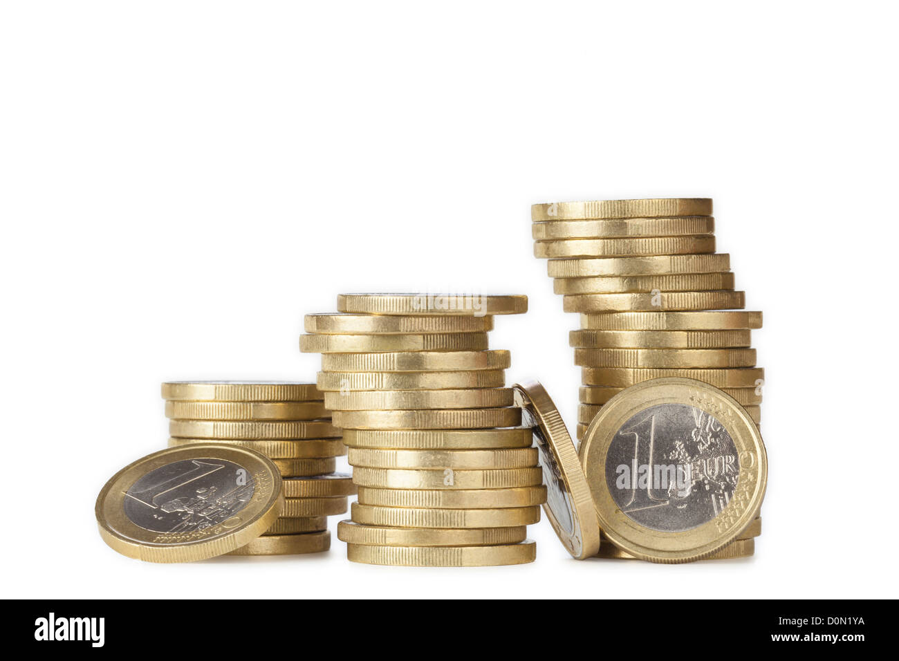 wobbly piles of euro coins - Stock Image