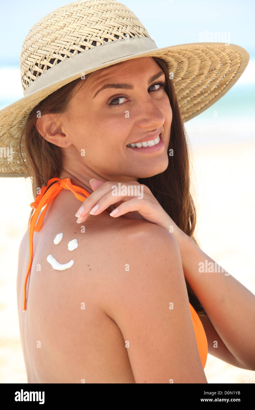 woman with sunscreen - Stock Image