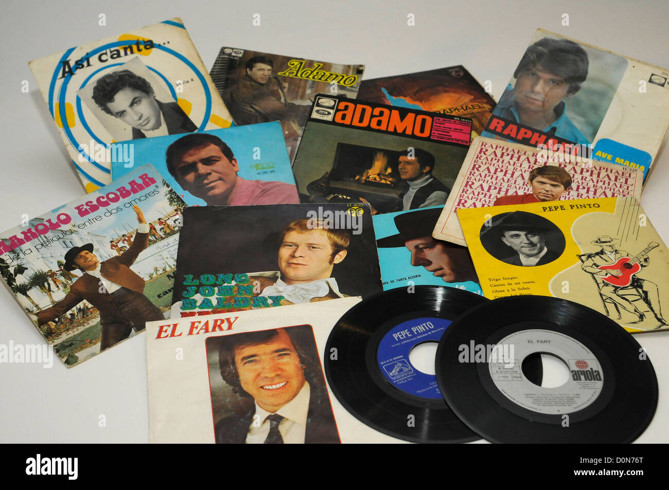 old vinyl singles disks from sixties, by Spanish and other countries singers. Collectibles. - Stock Image