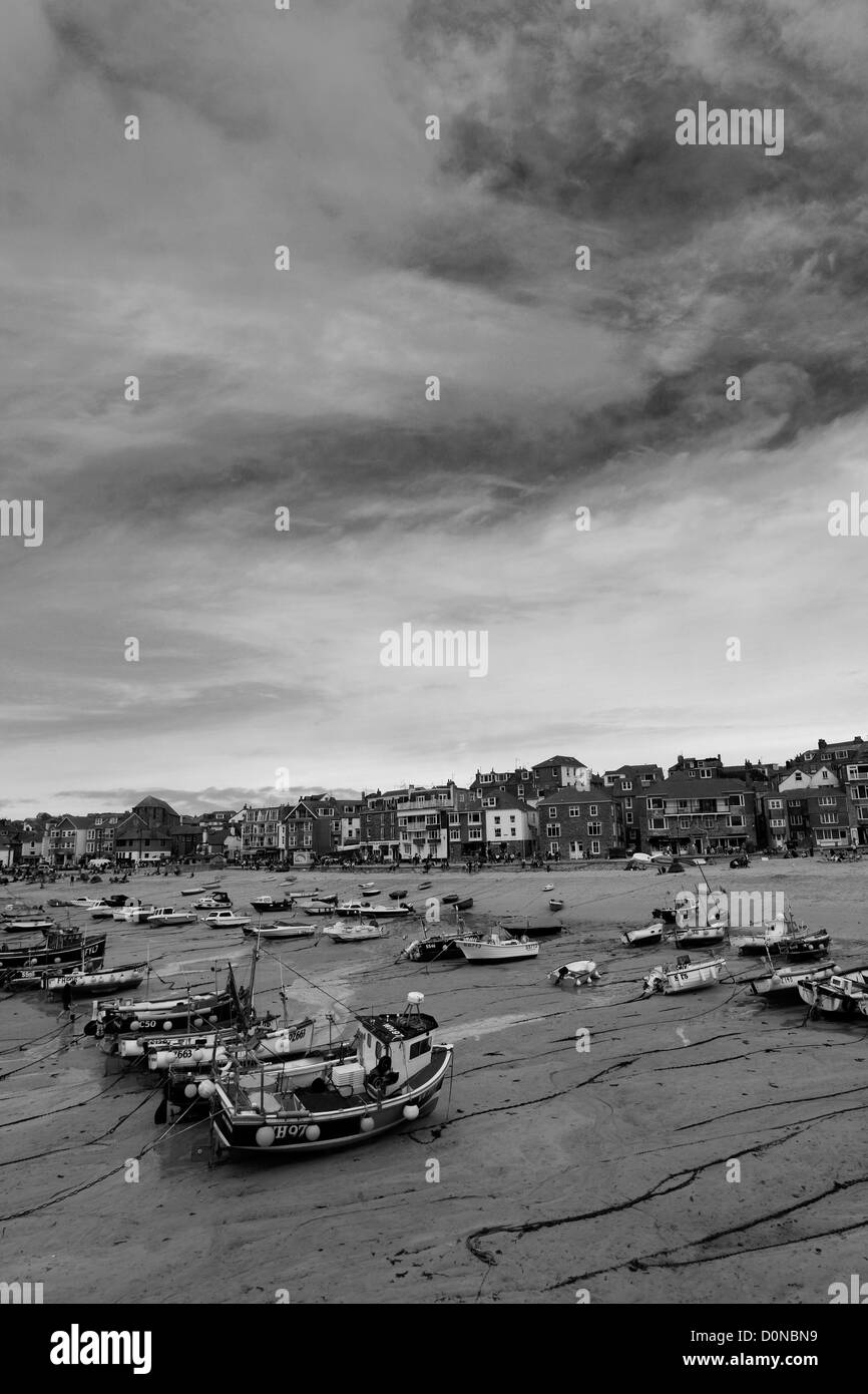 Black and White panoramic image, Fishing boats in the harbour, St Ives town, St Ives Bay, Cornwall County; England; Stock Photo