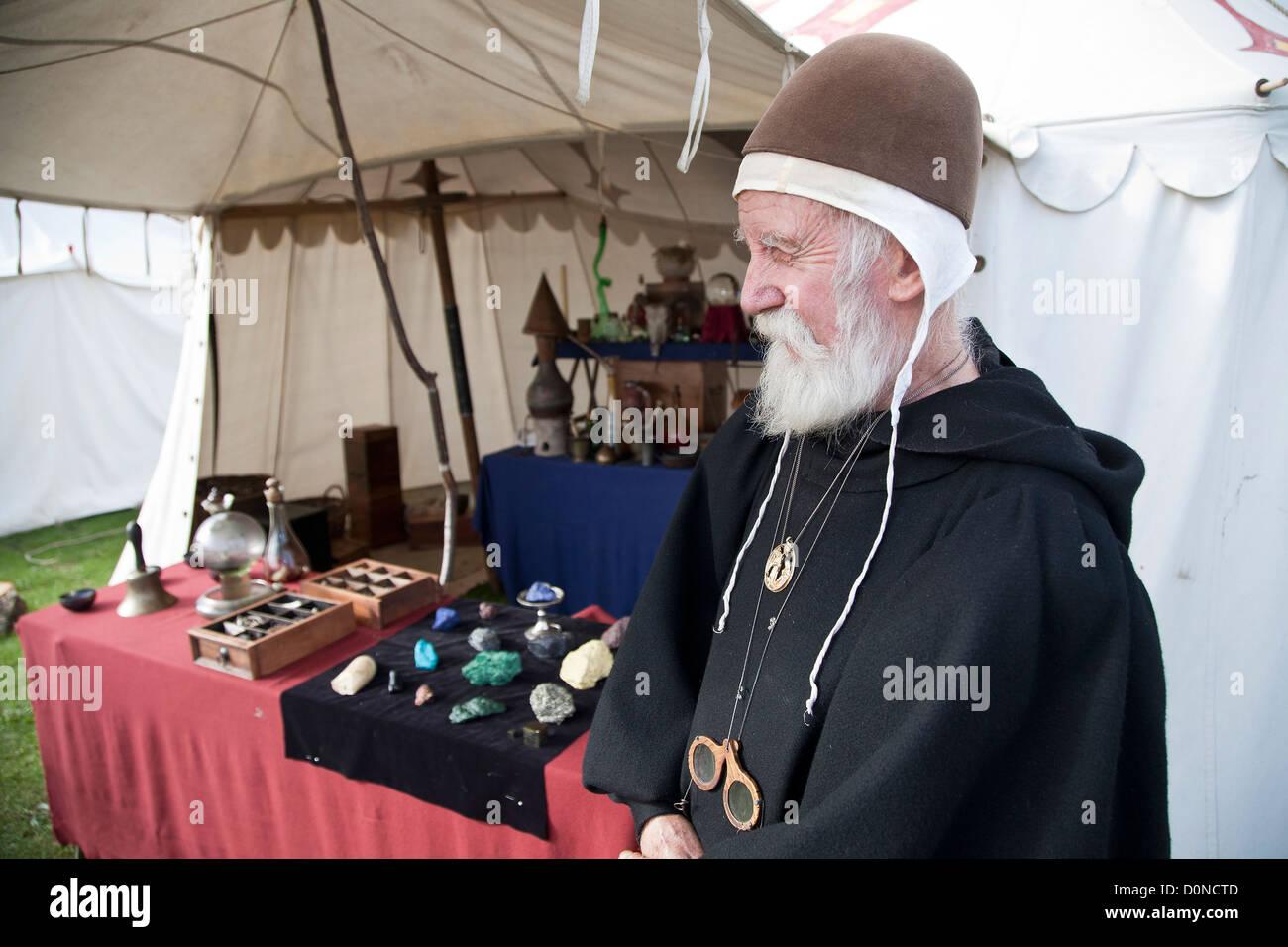 Alchemist 'Doctor John Greene' showcases his famed Tudor experiments at medieval fayre - Stock Image