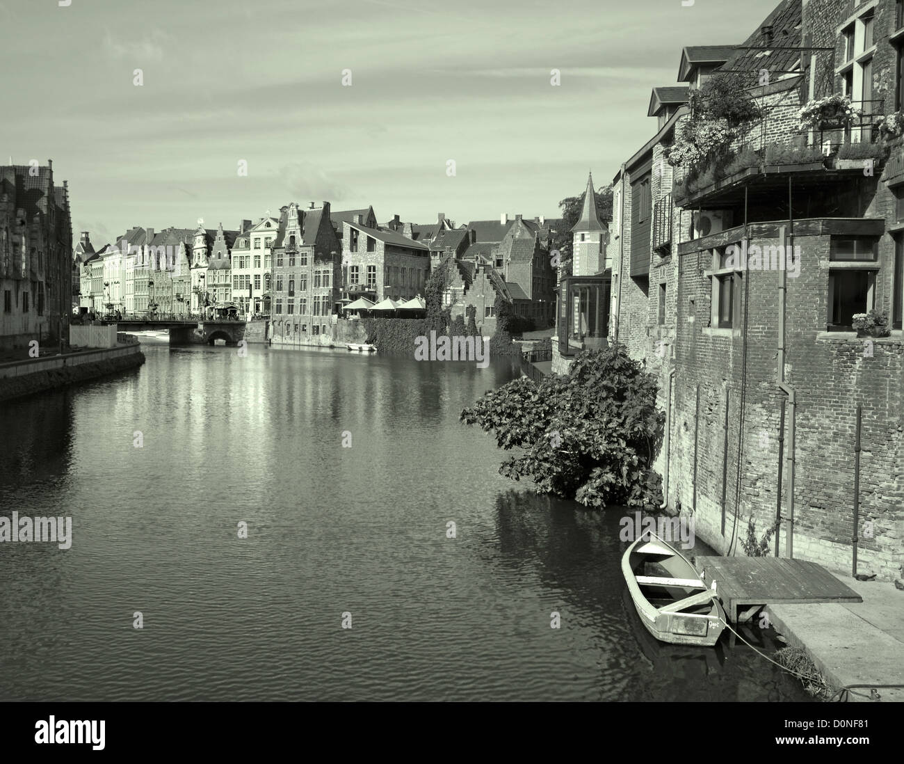 Ghent - canal and typical brick houses in morning light - Stock Image