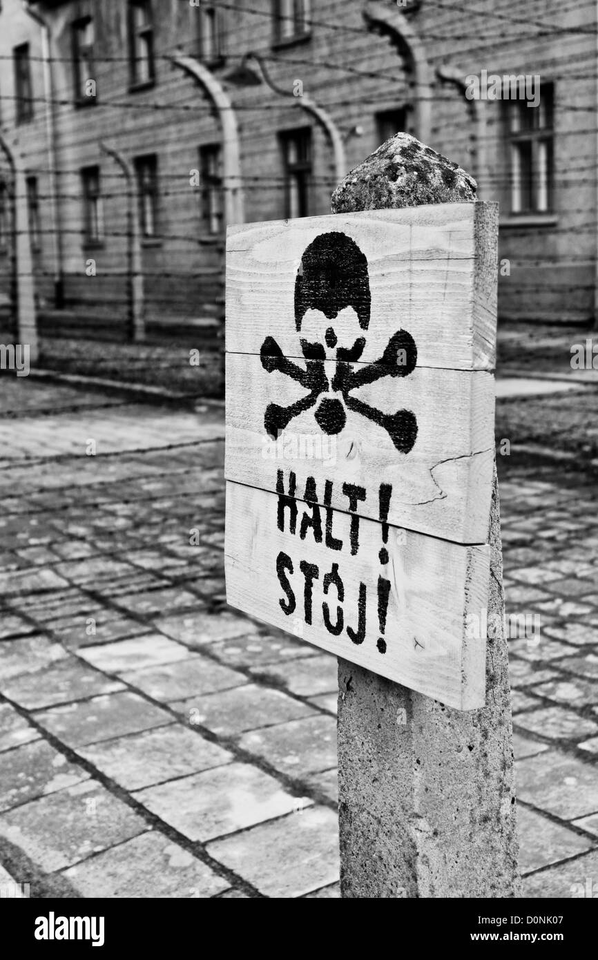 a death's head sign in Auschwitz concentration camp - Stock Image
