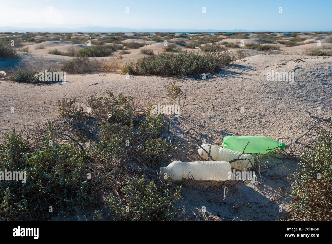 Old rubbish discarded on a remote desert island concept environmental issues - Stock Image