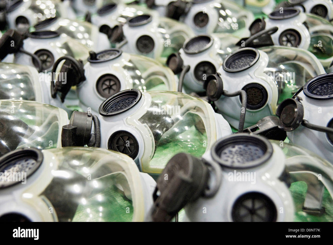 Dozens gas masks lie in basin after being washed turned in 35th Logistics Readiness Squadron supply warehouse Misawa - Stock Image