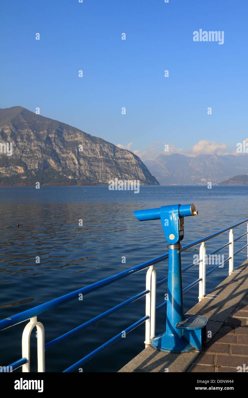 Coin operated telescope, Lake Iseo near Bergamo, Lombardy, Italy, Europe. - Stock Image