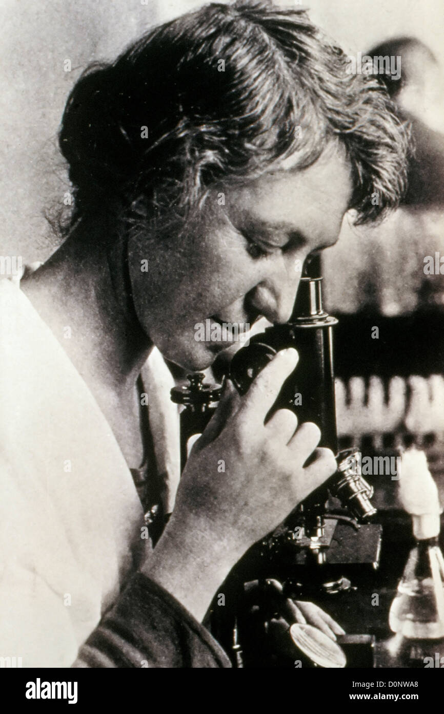 Bacteriologist Dr. Ida A. Bengston (1881-1952) uses microscope in image U.S. Public Health Service records. Dr. - Stock Image