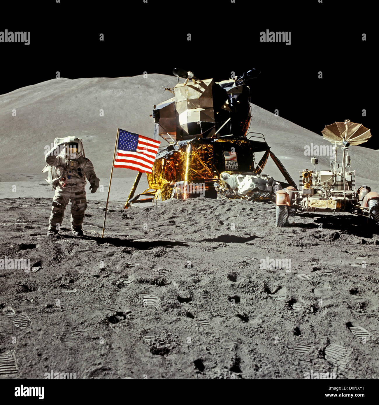 Apollo 15 Astronaut Saluting on the Moon With the Lunar Lander Falcon and Rover - Stock Image