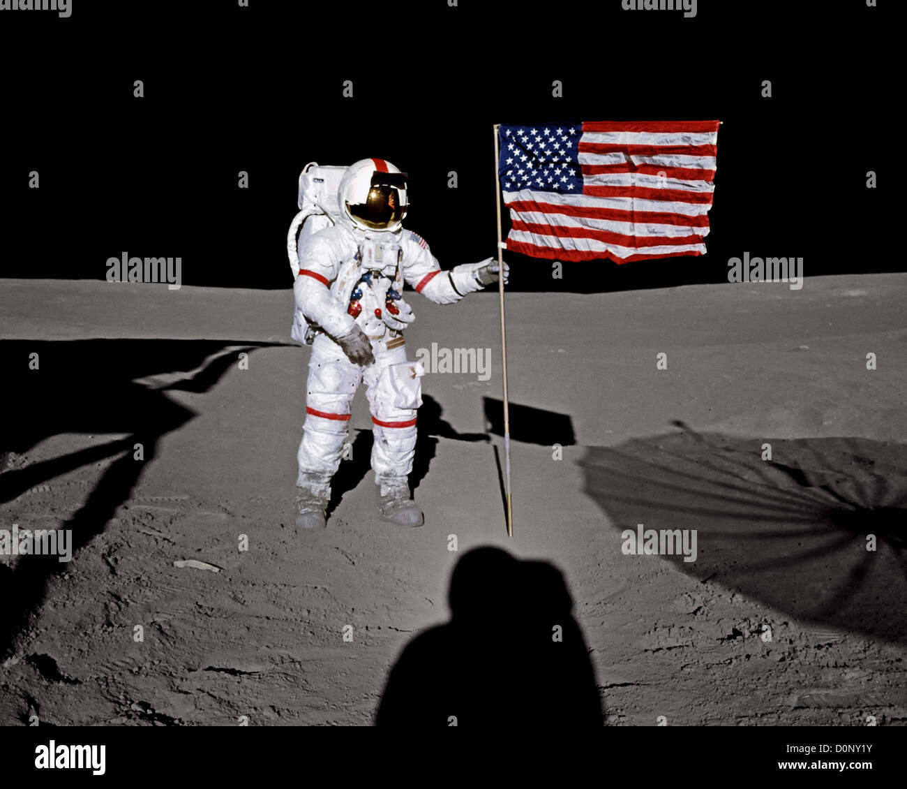 Alan Shepard Poses with An American Flag During Apollo 14 Stock Photo