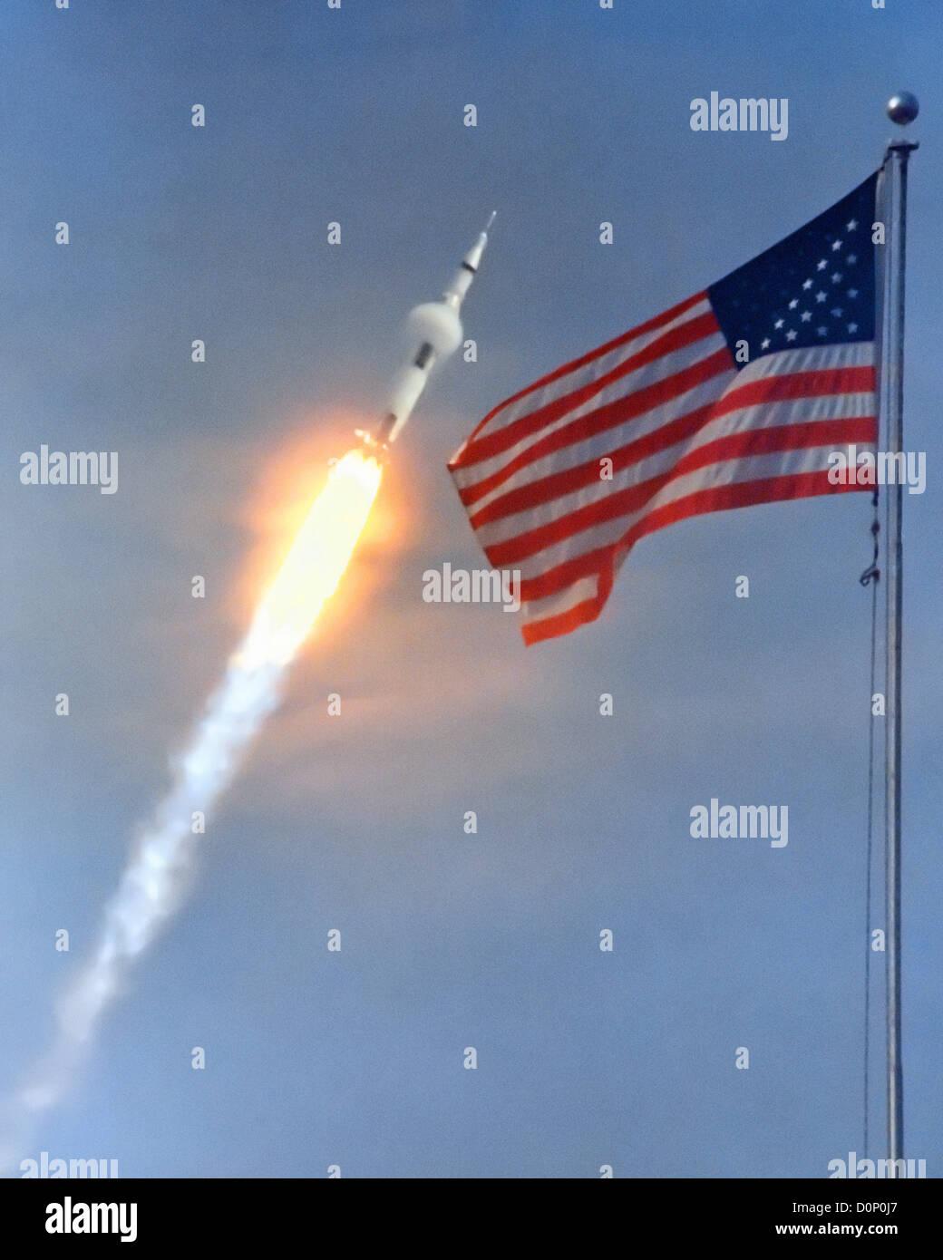 Apollo 11 Launches Past American Flag - Stock Image