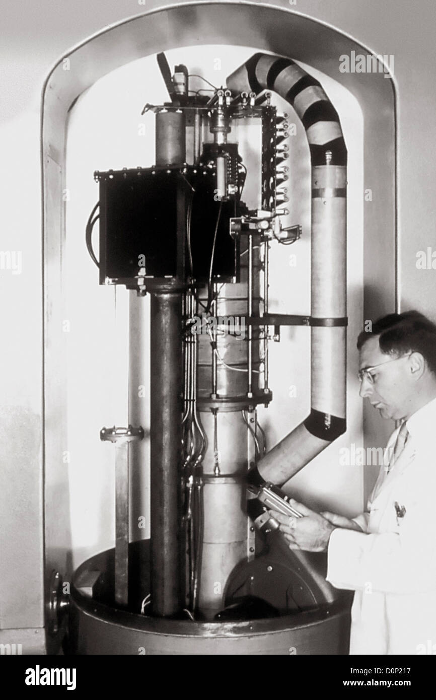 Dr. Henry Kaplan in 1950s early model linear accelerator developed treat cancer. this picture protective hood was - Stock Image