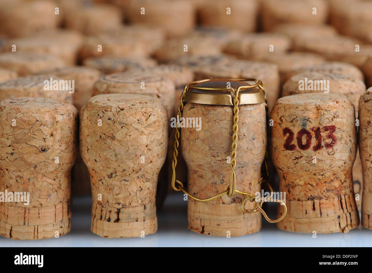 Closeup of a large group of Champagne corks, that fill the frame. Selective focus on the front row. One cork has - Stock Image