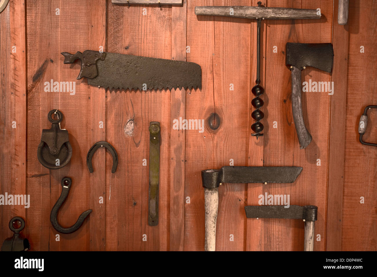 GA00145-00...GEORGIA - Display of old farm tools as part of the historic Relihan Cabin in General Coffee State Park. Stock Photo