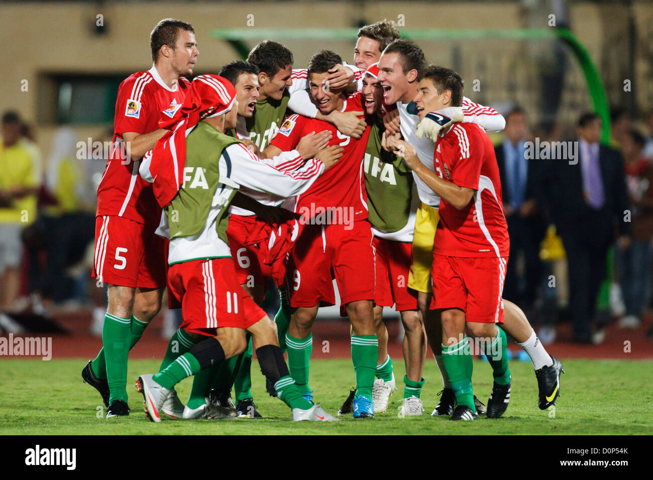 Hungary team players celebrate their victory over Italy in a 2009 FIFA U-20 World Cup quarterfinal match at Mubarak Stock Photo