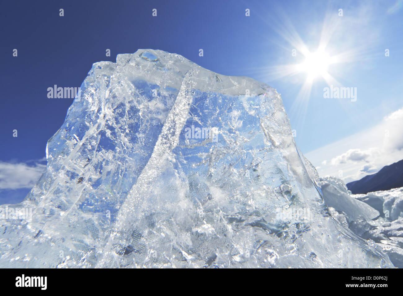 Piece of ice and the sun on winter Lake Baikal - Stock Image