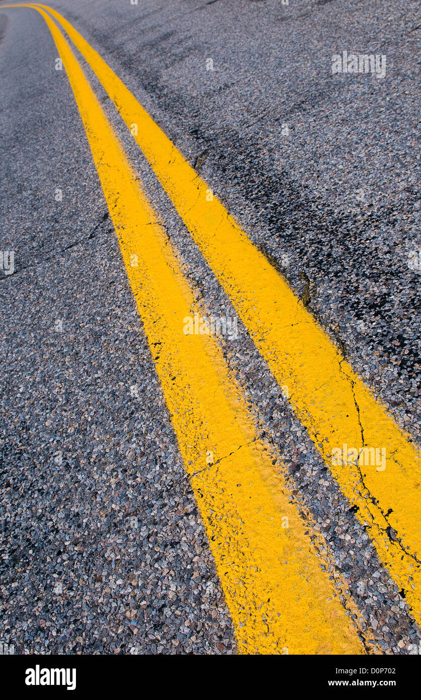 yellow dividing lines on the highway - Stock Image