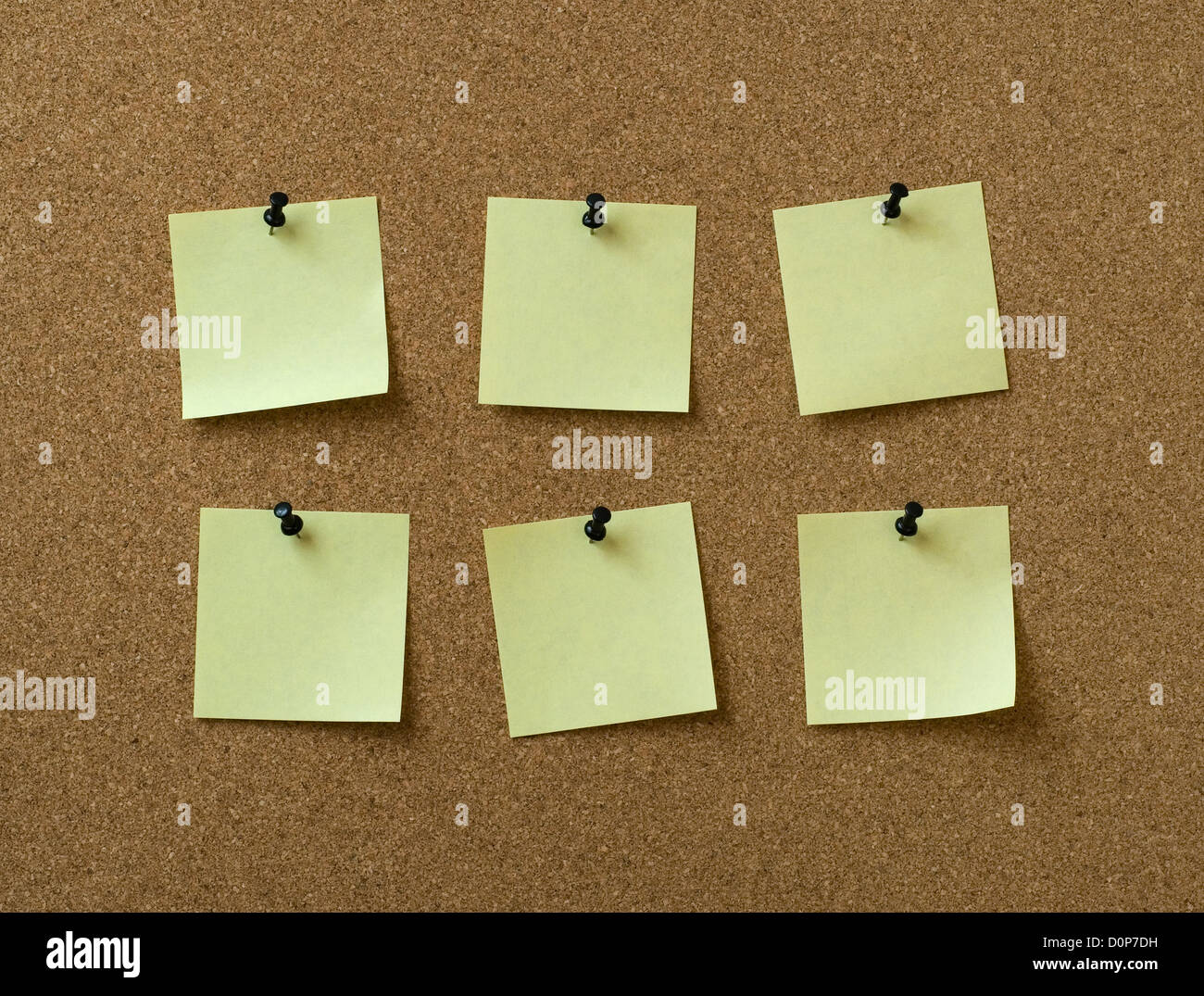 six yellow notes pinned to cork background - Stock Image