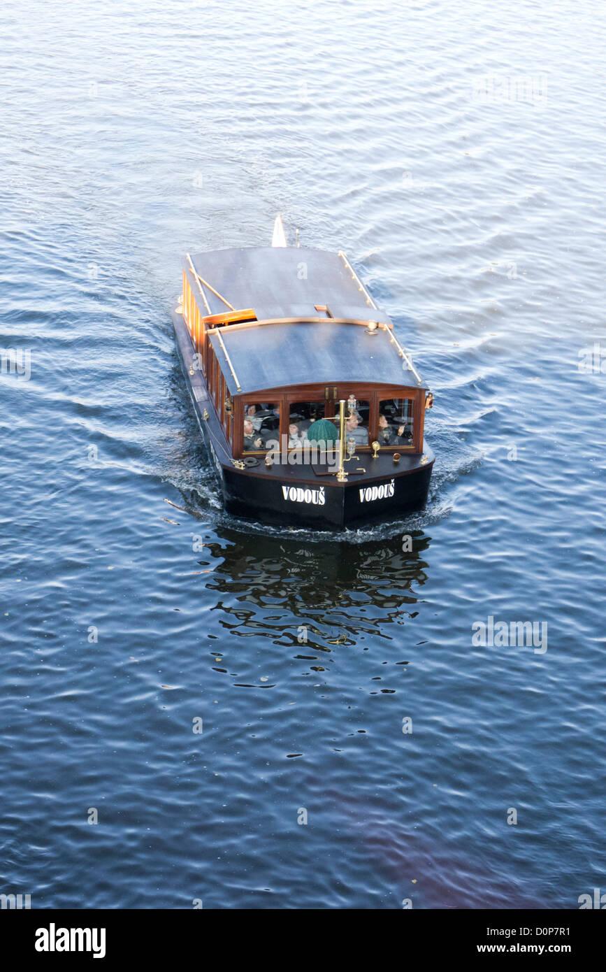tourist's boat on the Vltava river in Prague - Stock Image