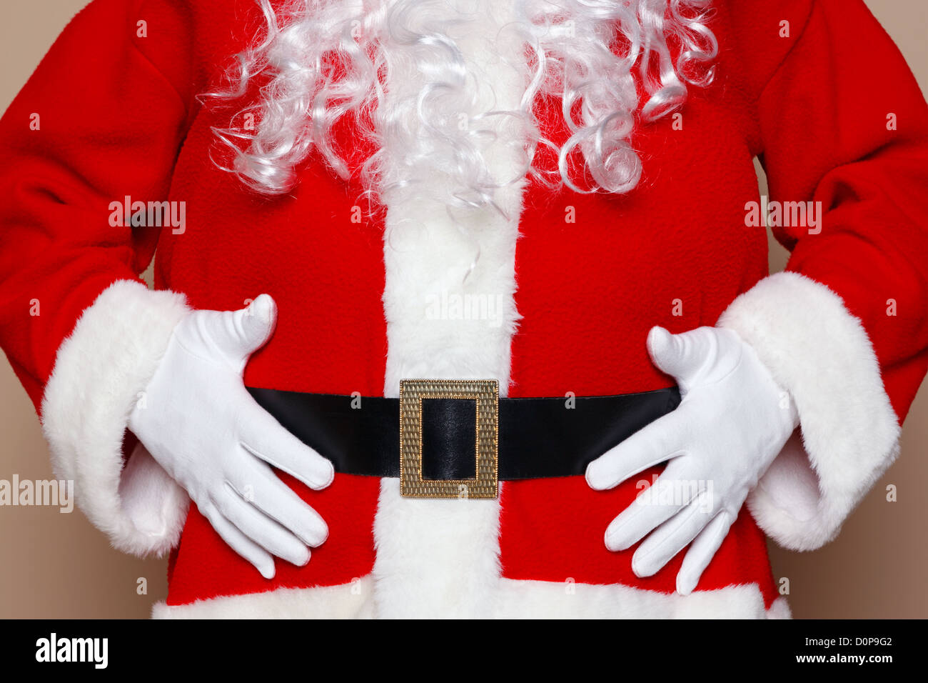 Santa Claus holding his belly, two many cookies I think. - Stock Image