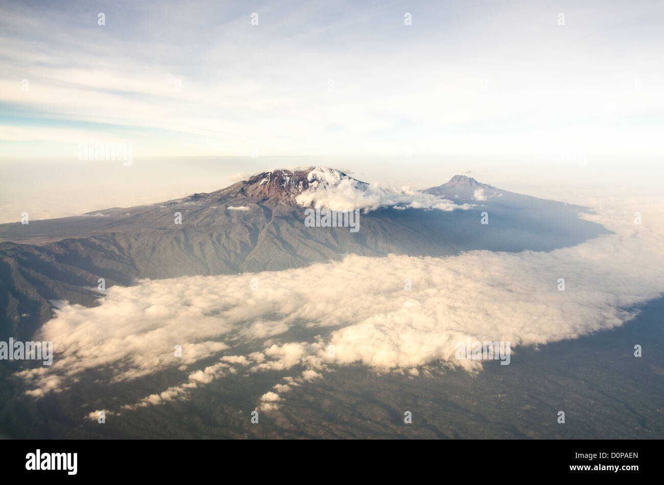 MT KILIMANJARO, Tanzania - Mount Kilimanjaro Aerial View with Clouds. An aerial view of Mount Kilimanjaro, the highest - Stock Image