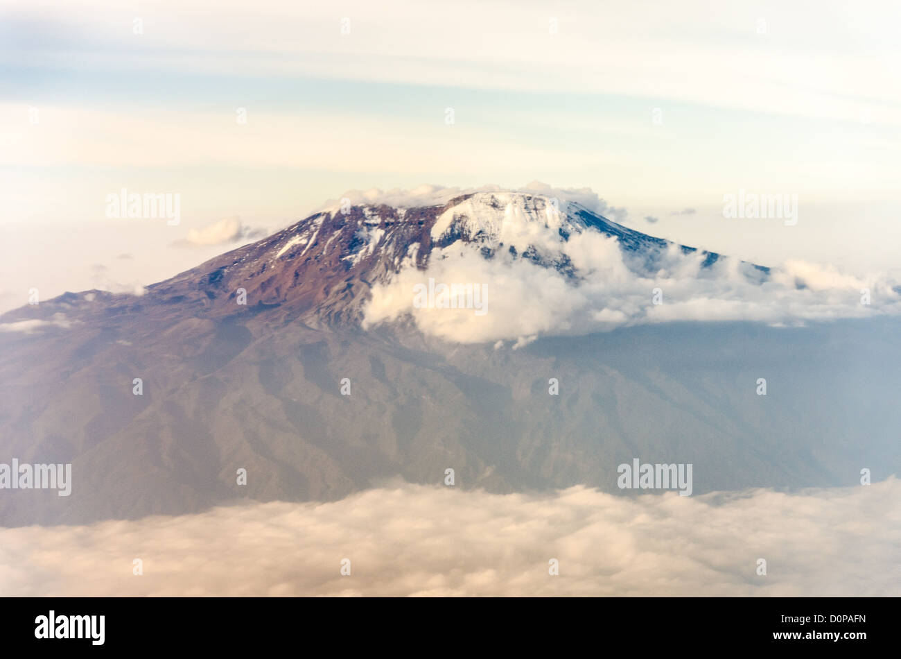 An aerial shot of the summit of Mt Kilimanjaro in Tanzania, with snow and clouds. - Stock Image