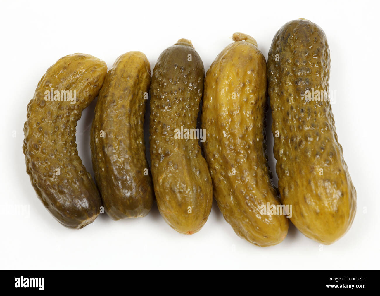 Gherkin pickles closeup on white background - Stock Image