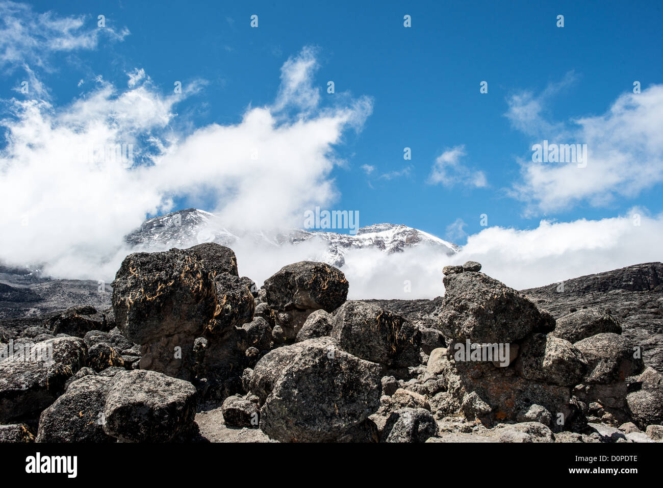 MT KILIMANJARO, Tanzania - The summit of Mt Kilimanjaro is in the distance, partly obscured by clouds, as seen from - Stock Image